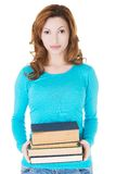 Student woman holding heavy books Royalty Free Stock Photography
