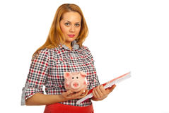 Student woman holding piggy bank Stock Images