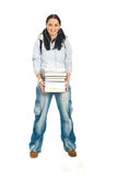 Student woman holding stack of books. Full length of happy student woman with earphones holding stack of books isolated on white background Stock Images