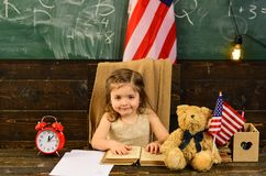 Student woman holding USA flag. Child and demonstrating openness is must for tutor. Pupil is having one-on-one time with stock photos