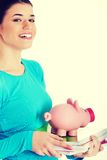 Student woman holding workbook and piggy-bank. Royalty Free Stock Images
