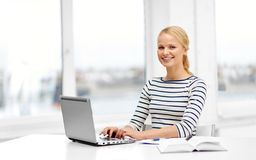 Student woman with laptop and book. Education, school and learning concept - student woman with laptop computer and book at home stock photography
