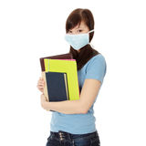 Student woman with mask on her face. Stock Photo
