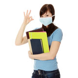 Student woman with mask on her face. Stock Image