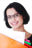Student woman with notebooks. Happy student woman with notebooks showing her degree, isoalted on white background Royalty Free Stock Photos