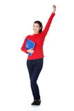 Student woman with notebooks showing win gesture. Happy student woman with notebooks showing win gesture with fist, isoalted on white background Stock Photos