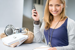 Student woman with notes and cellphone Royalty Free Stock Image
