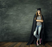 Student Woman over Blackboard Background, School Girl Mortarboard. Student Woman over Blackboard Background, School Girl in Mortarboard Graduation Hat, Education royalty free stock photography