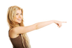 Student woman pointing to the right Stock Photo