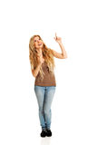 Student woman pointing up Royalty Free Stock Image