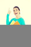 Student woman pointing up. Stock Photography