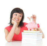Student woman putting euro in piggy bank Stock Photography