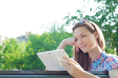 Student woman reading tablet computer Stock Photo