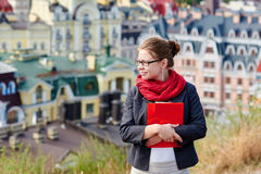 Student woman on the reverse against the background of the city Stock Photography