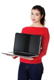 Student woman showing her laptop.  stock photography