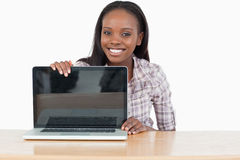 Student woman showing a screen Royalty Free Stock Image