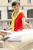 Student woman sitting near fountain Royalty Free Stock Image