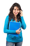 Student woman talking with phone. Young student woman with notebook talking with phone over a white background Stock Photography