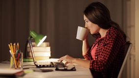 Student or woman typing on laptop at night home. Education, business, overwork and people concept - woman or student girl typing on laptop computer at night home stock footage