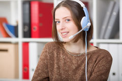 Student woman uses a headset with a microphone for online learning university. Woman uses a headset with a microphone for online learning university Stock Photos