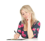 Student woman writing on black clipboard Stock Image