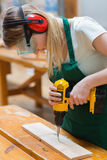Student in a woodwork class using a drill Royalty Free Stock Photography