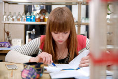 A student at work in laboratory of chemistry studies the records Stock Photography