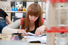 A student at work in laboratory of chemistry studies the records Stock Photo