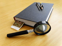Student work table top. An image of a pair of mathematical compass placed on a thick closed book on a wooden table top. Taken with a magnifying glass in bright Royalty Free Stock Images