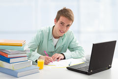Student working on computer. Student studing for exam, working on computer Royalty Free Stock Image