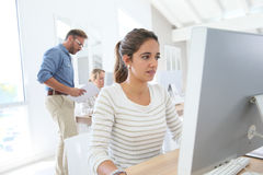 Student working girl on desktop computer in class Stock Photo