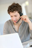 Student working at home with headset learning foreign language Stock Photography