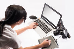 Student working on a laptop computer. Isolated over a white background Royalty Free Stock Photo