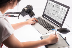 Student working on a laptop computer. Isolated over a white background Stock Images
