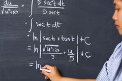 Student working on mathematics problem royalty free stock image
