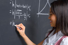 Student working on mathematics problem Stock Photos