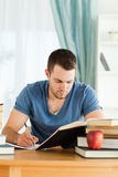 Student working through subject materials Royalty Free Stock Image