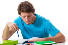 Student working on task. Male student working on task on isolated background Royalty Free Stock Photos
