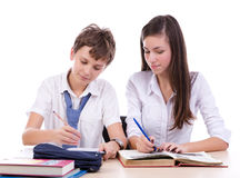 Student working together. At there homework isolated on white background Stock Photos