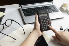 The student works for a final exam in mathematics, physics, chemistry. royalty free stock image