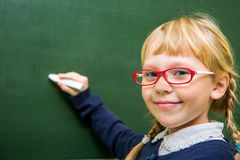 Student works in a school classroom, child at school, Stock Photography