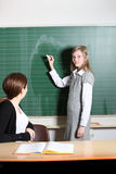 Student  writes on the blackboard Royalty Free Stock Images