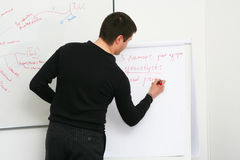 Student writes on the board Royalty Free Stock Images