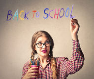 Student writing back to school. Young student ready to be back at school Stock Photography