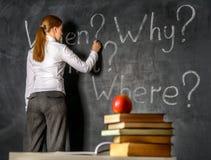 Student writing on blackboard Stock Photos