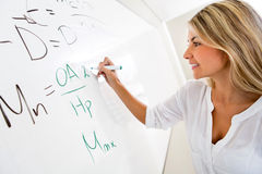 Student writing on the board Royalty Free Stock Photo