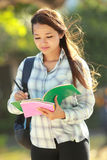 Student writing on the books Stock Photography