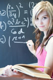 Student writing on the chalkboard Royalty Free Stock Images