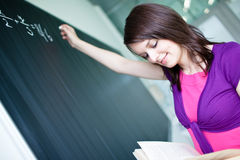 Student writing on the chalkboard Stock Image