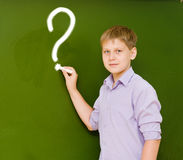 Student writing on the chalkboard.  Royalty Free Stock Image